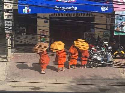 Buddhist monks collecting alms at breakfastime